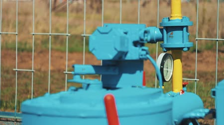 bitki : Gas equipment at the station. Pipeline with valve. Gas processing plant. Gauges and pipeline gas main. Gas and oil production industry Stok Video