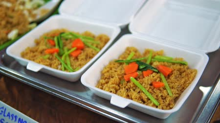 pepino : Fried rice with vegetables on plastic plates, traditional street food close up