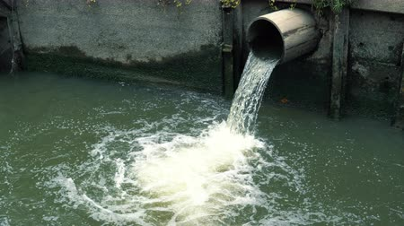 culvert : Rainwater flows into the canal through the city sewer system Stock Footage