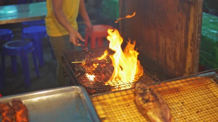 saute : Chef cook chicken saute on grill at food market