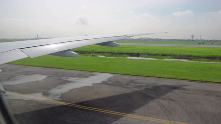 view from the window of the aircraft on the wing and runway. passenger and cargo transportation by air
