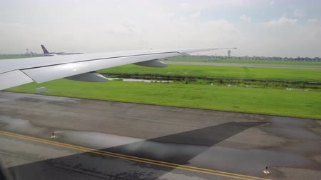 air transportation and travel. the plane is preparing to take off on the runway. the wing of the aircraft from the window