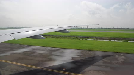 the plane on the runway. the wing of the aircraft from the window