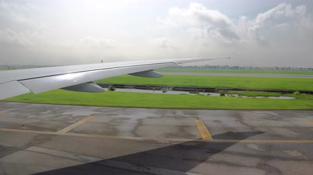 the plane on the takeoff strip is preparing for takeoff. view from the window on the wing of the aircraft