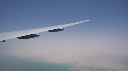 an airplane wing with the clouds. cargo and passenger air transportation. air flight Стоковые видеозаписи
