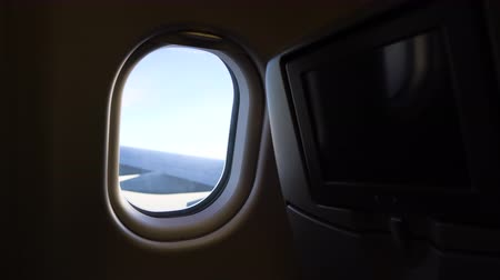 the window of the plane and wing. air flight