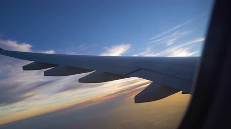 the wing of the aircraft at sunset. air transportation and travel. aviation