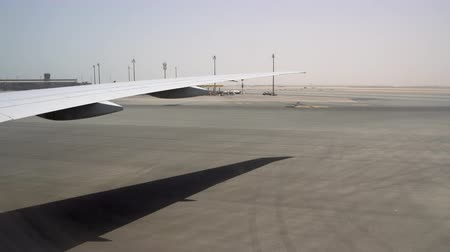 The wing of a large aircraft under the scorching sun. Beautiful skyline in the background