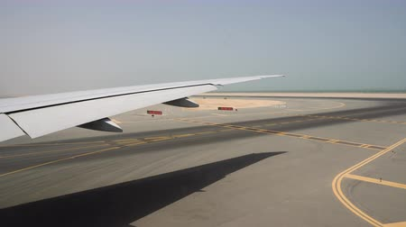 Runway in hot Sunny weather, view through the aircraft window Стоковые видеозаписи