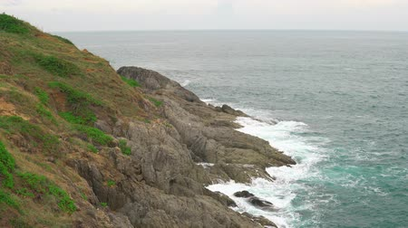 Scenic view of the cliff. The turquoise ocean surrounds a tropical island