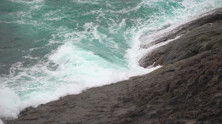 Powerful waves beating against the rocks. Turquoise water in the tropical sea