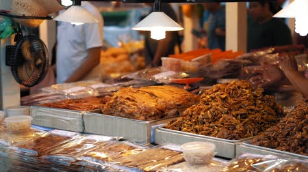 satılır : Traditional Asian food is sold on the street. Slow motion, local night food market at hot evening