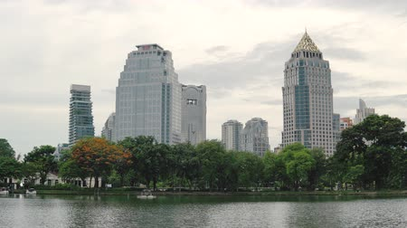 peyzajlı : View of tall office buildings from Lumpini Park. Large lake in the famous Park in the center of Bangkok city