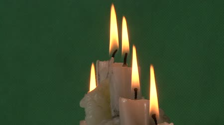 сжигание : candles on a green background Стоковые видеозаписи