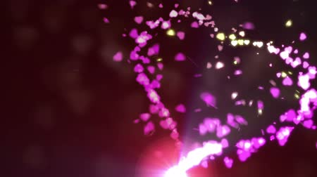 red symbol : Burning sparks creating pink rose petal forming heart shape Stock Footage