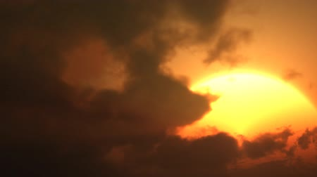evening sun : Beautiful golden time lapse sunset through many layers of clouds. Stock Footage
