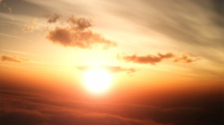 evening sun : Flying towards a beautiful sunset above the reddish clouds. Stock Footage