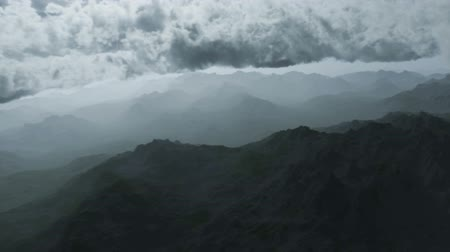 горный хребет : Aerial shot of flying over cloudy sky over reviewing mountain range