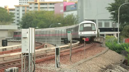 modern train wagon : A modern train is moving out of the station cutting across the camera Stock Footage