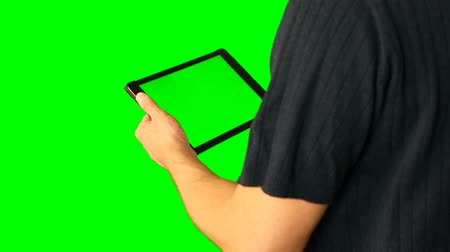 touchpad : Man using tablet with green screen doubled on big screen.