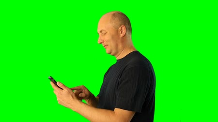 żart : Adult man using smartphone half-face view