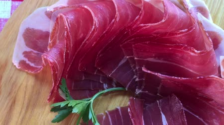 žalud : Top view of jamon slices, close up view zoom out. Prosciutto thinly sliced and served uncooked.