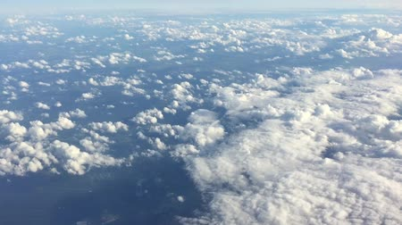 avançar : Sky clouds background. Flight high above land in clouds. On sky view. Aerial flyght in blue sky. Heavenly sky view of fly through clouds.