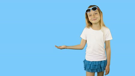 brancos : Modest little girl laughs and holds a hand with an empty palm. Template for advertising. Can put something on the girls hand. Clip with Premultiplied matted Alpha Channel. Transparent PNG format.