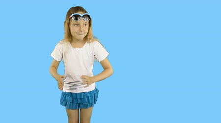 řev : Little girl is showing her finger and dancing.. Girl in sunglasses and a T-shirt. Clip with Premultiplied matted Alpha Channel. Transparent background PNG format. Include slow motion part.