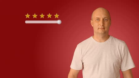 avaliação : Feedback five stars from man on virtual screen. Young man move slider to set rating of services from one to five star. Caucasian man smiling and show thumbs up.