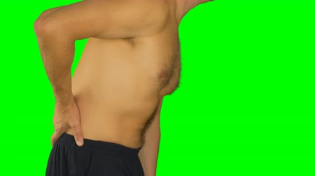 arka görünüm : White man on green screen side view. Man go and hold hands on lower back. Lower back pain.