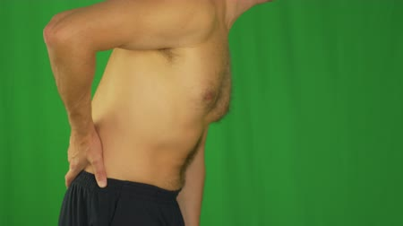 chafe : Side view of caucasian man torso. Man stroking lower back by hands. Stock Footage