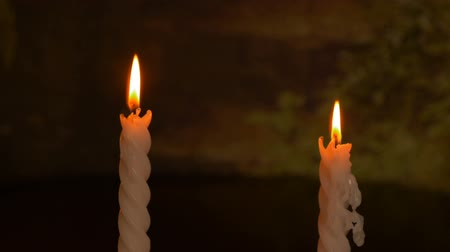 cera : Two big burning candles. Bright light on dark background. Darkness template. Birthday party. Romantic evening on Valentine. Stock Footage