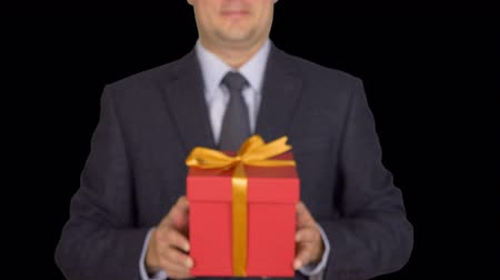 ajándékdobozban : Businessman present red gift box with ribbon bow, front view, isolated over transparent background.