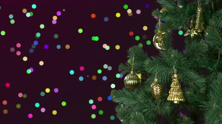ladin : Abstract background Christmas celebrate. Christmas holiday eve. Green fir tree with gold decor. Greeting Christmas and New Year. Glitter colorful bokeh lights at background. Shiny confetti circles.