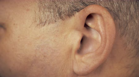 arcszín : Man left ear. Macro extreme close up view of male ear. Concept for audio music sound health human ear.