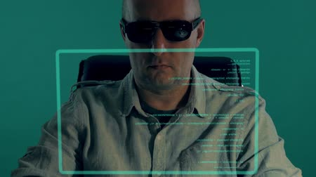 programa : Bald white officer sits in front of virtual screen and typing program code. Man in dark glasses write script expliot for password decrypting. Access granted for hacker. Download critical data. Vídeos