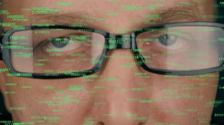 vidět : Futuristic monitor on face with code and information hologram. Eye hud animation. Future concept. Man face in glasses.