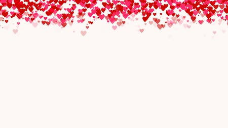 абстрактный фон : Seamless loop background with different colored confetti hearts for valentine time.