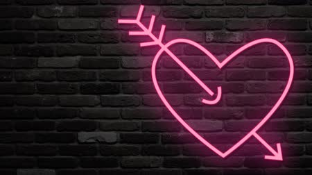duše : Neon light glow at dark brick background. Arrow shot heart symbol of love. Half with brick background for use as is. Second with alpha channel. Put it on own any wall background and scale.