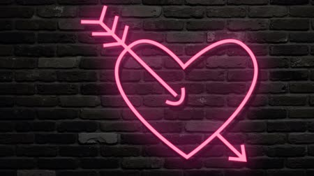 izzók : Red pink heart amazed by arrow. Neon glow flashings. Turn on and turn off. Dark brick background. Pink light electric fluorescent.