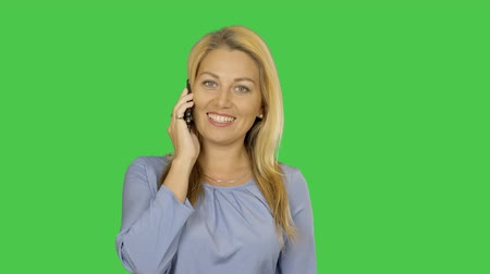 седые волосы : Adult caucasian girl speaks by cell phone and smiling. White blonde female use phone for conversation communication. Alpha Channel transparent background.