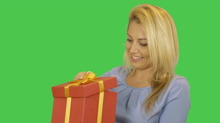 jóquei : Girl get red gift box. Young woman happy blonde hair take present. Alpha channel