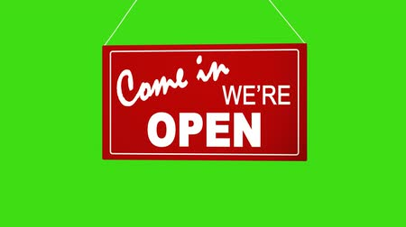 Войти : Sign board drop from top: come in we are open. Retail shop sign. Business animation. White sign on red. Board at ropes. Alpha channel keyed green screen. Стоковые видеозаписи
