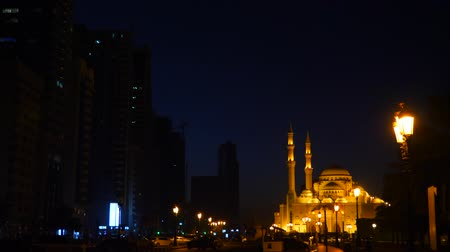 mussulman : Camera motion from mosque to crescent. Dark arabian night. Mosque illuminated with gold lights. Lanterns at path pedestrian road.