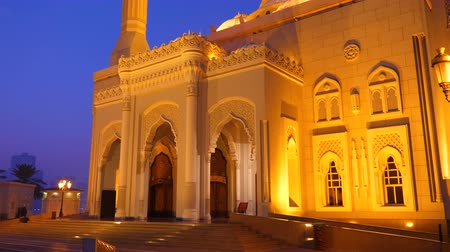 mussulman : Dolly shot Al Noor Mosque in Sharjah city UAE. Night view illuminated mosque. Islam worship. Gold lights of lantern. Cobalt color of sky.