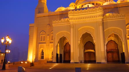 mussulman : Facade of Al Noor Mosque in Sharjah Emirates. Night view illuminated building.