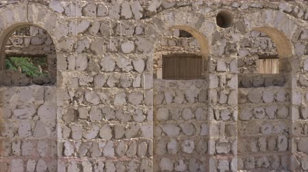 onarılmış : Repaired ancient wall with arches, columns and circles in summer