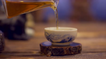 chinese culture : Chinese tea ceremony with glass teapot and traditional cup