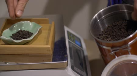 ceramika : Organic dried tea brewing on electronic scales.